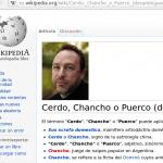 Foto de Jimmy Wales junto a la palabra cerdo
